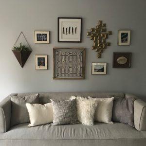 grey sofa with pillows